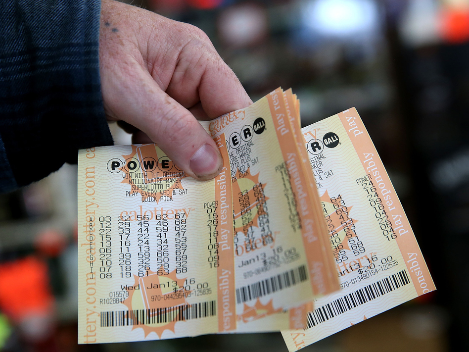 We know these are not the winning tickets. A customer holds a handful of Powerball tickets Wednesday at Kavanagh Liquors in San Lorenzo, Calif. (Justin Sullivan/Getty Images)