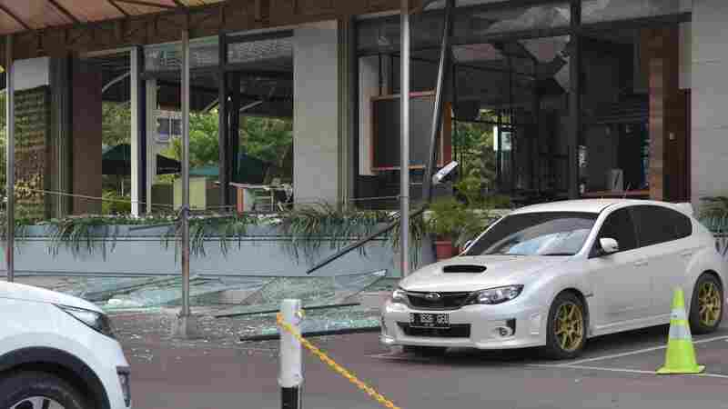 A damaged Starbucks coffee shop is seen in central Jakarta, after a series of explosions hit a popular shopping area Thursday.