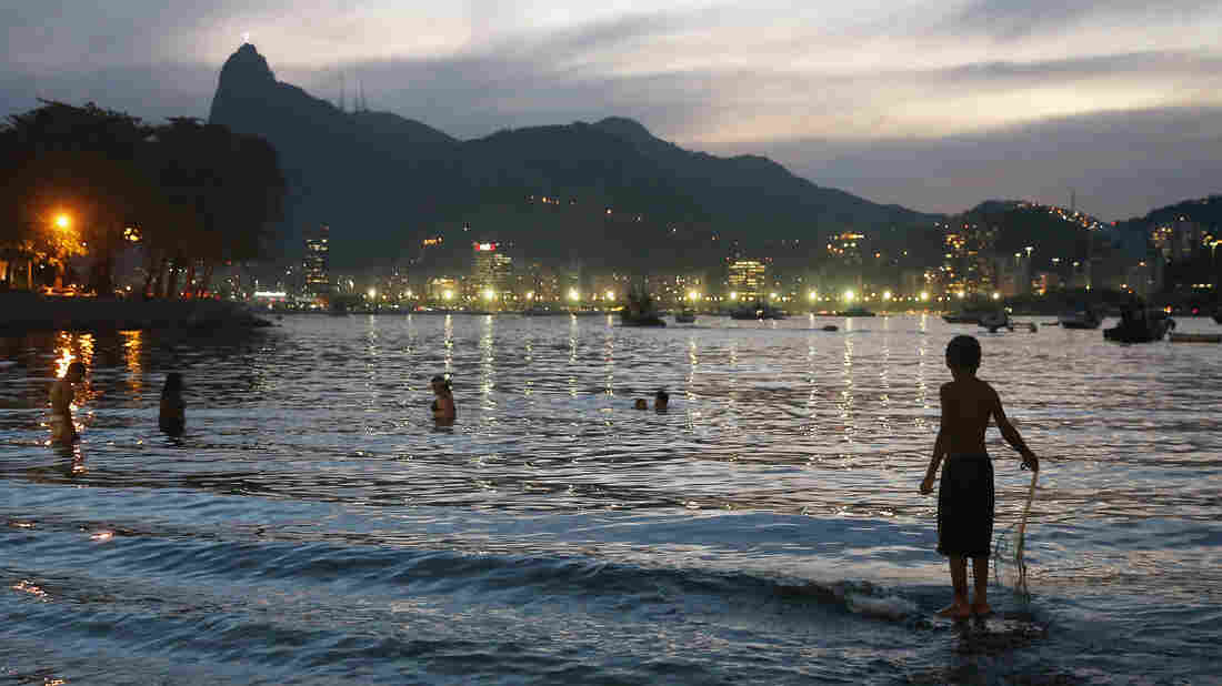 A boy fishes in polluted Guanabara Bay in Rio de Janeiro in August 2015. The bay will be the sailing venue for the Olympic Games this summer. Brazil is facing concerns over polluted water, mass transportation and budget issues as it prepares for the games.