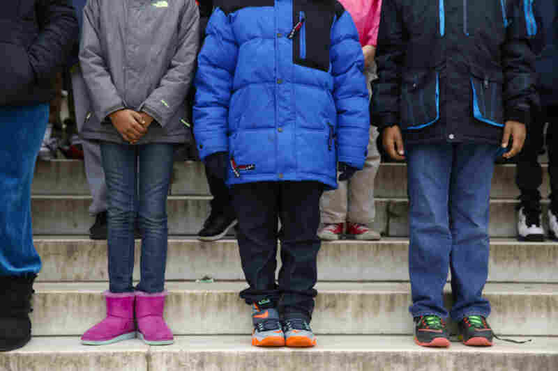Each child memorized one small phrase from Martin Luther King, Jr.'s speech. They're standing in the order that they will deliver their line.