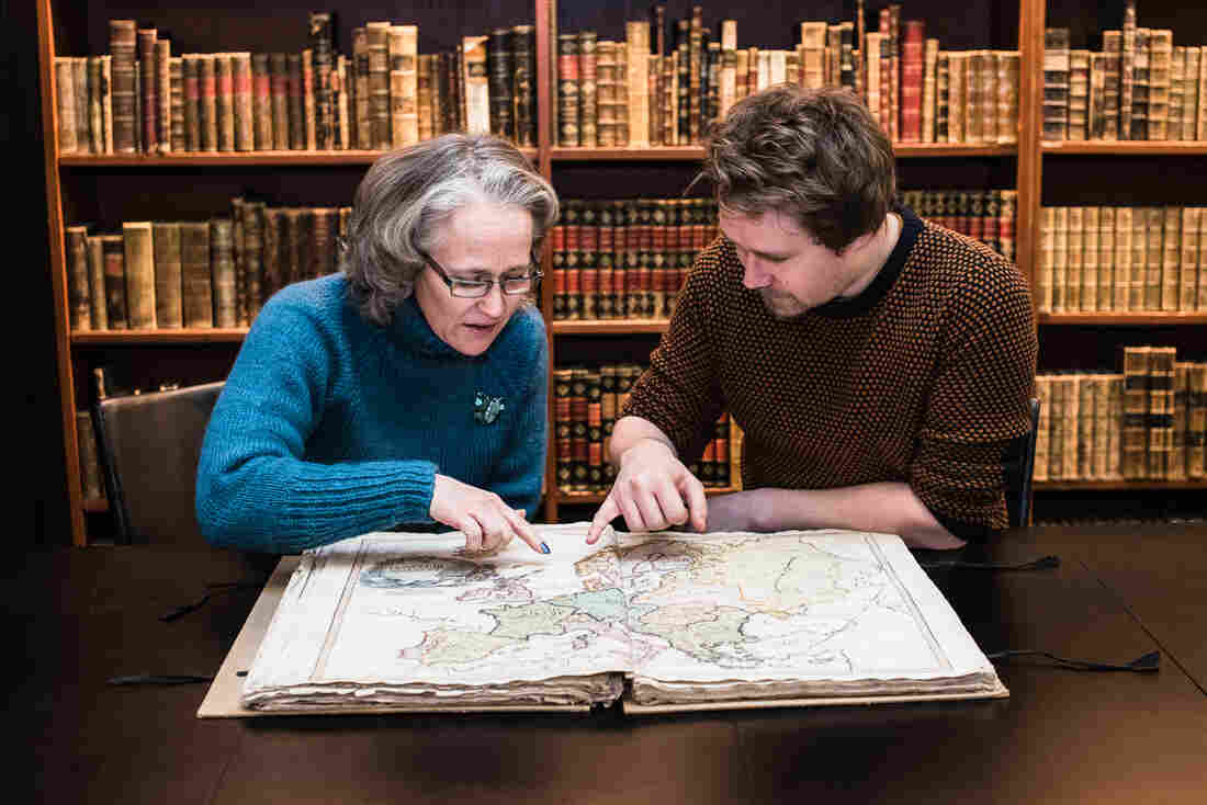 Reference librarian Anders Kvernberg (right) discovered the Cedid in the library's vaults. Research librarian and map historian Benedicte Gamborg Briså (left) confirmed its authenticity.