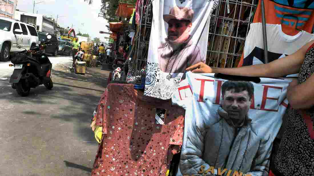 "A vendor shows a t-shirt with the face of Joaquin ""El Chapo"" Guzmán for sale in Mexico City on July 20, 2015."