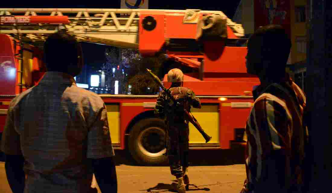 A soldier stands near a hotel that was attacked by militants on Friday in Burkina Faso's capital, Ouagadougou.
