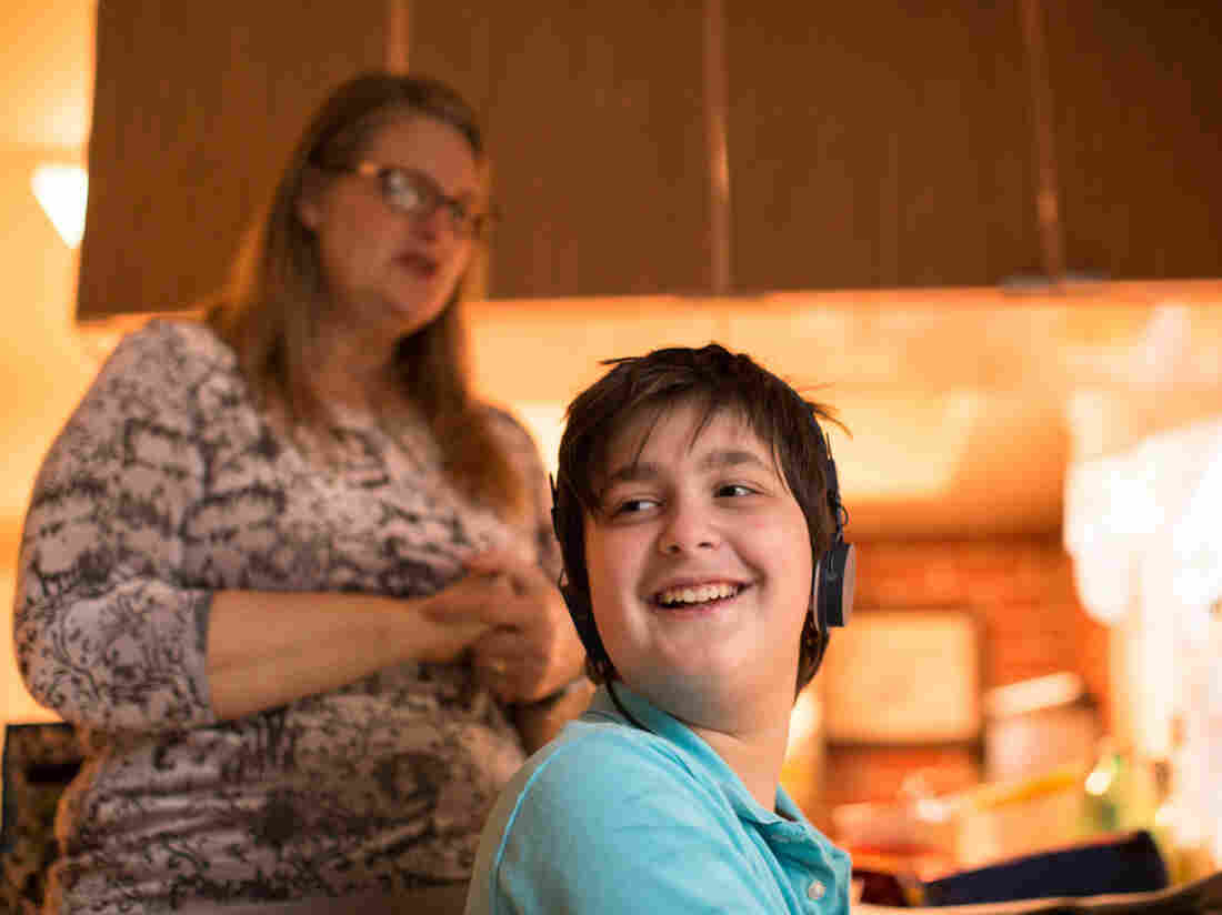 Christy Hammett and her son Francis Hammett watch videos online together after Francis gets home from school.