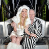 Model Crystal Hefner (L) and Hugh Hefner attend the annual Halloween Party, hosted by Playboy and Hugh Hefner, at the Playboy Mansion on October 24, 2015 in Los Angeles, California.