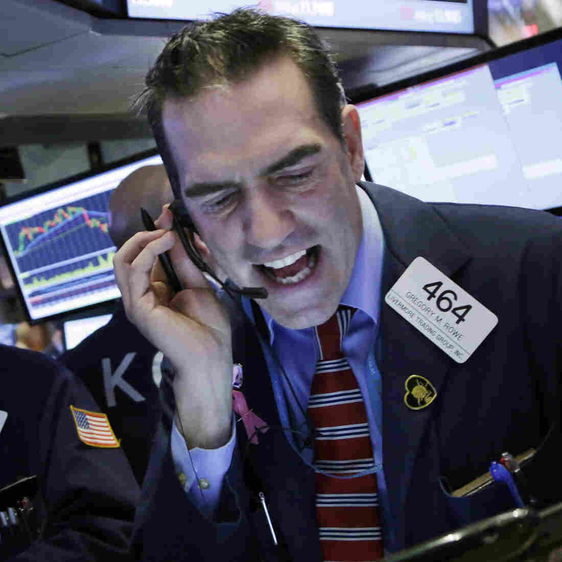 Trader Gregory Rowe works at the New York Stock Exchange on Friday, as U.S. markets were getting hit with panicky selling.
