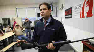 Republican presidential candidate Sen. Marco Rubio, R-Fla. holds a rifle during a campaign stop Jan. 15, 2016, at Sturm, Ruger & Co., in Newport, N.H.