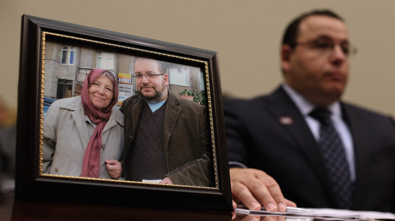 Ali Rezaian, brother of Washington Post Tehran Bureau Chief Jason Rezaian (shown in picture frame), talks about his brother's imprisonment in Iran while testifying before the House Foreign Affairs Committee on June 2, 2015. Iranian media outlets are reporting that Rezaian has been released.
