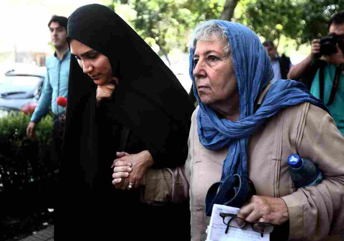 Mary Rezaian (right), the mother of detained Washington Post correspondent Jason Rezaian and his wife, Yeganeh Salehi (left), leave the Revolutionary Court after a hearing on Aug. 10, 2015, in Tehran. Rezaian is set to be released Saturday, as part of a prisoner exchange between Iran and the U.S.