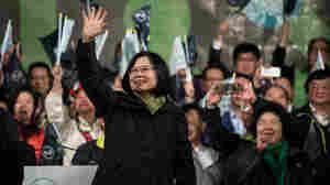 Democratic Progressive Party presidential candidate Tsai Ing-wen celebrates her victory in Taipei on January 15. Voters in Taiwan elected a Beijing-skeptic president in a dramatic democratic journey, carving their own political path against China's wishes.