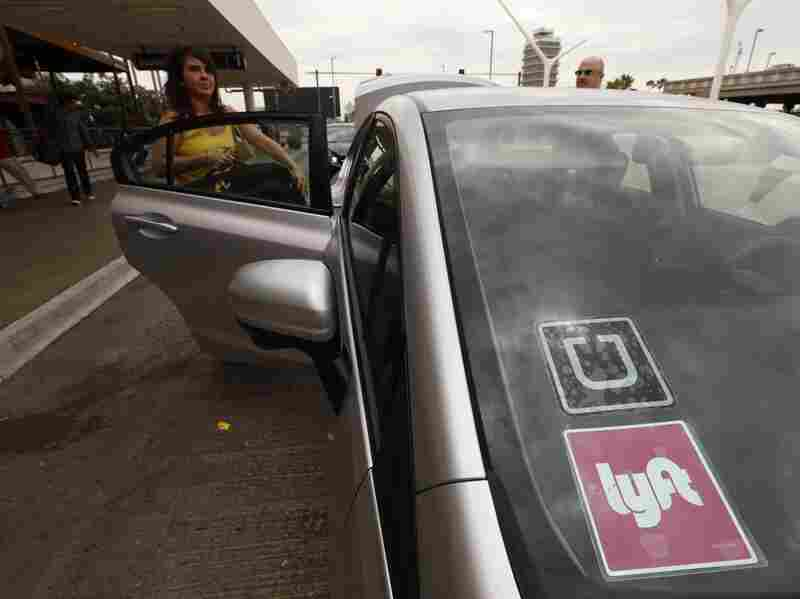 A car with Uber and Lyft stickers at Los Angeles International Airport. Uber dominates the fast-growing ride-hailing business. But Lyft is waging a spirited battle to keep up.