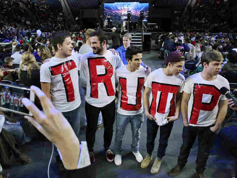 "Liberty University students (from left) Austin Miller, James Ford, Jeremy Boyd, Josiah O'Boyle and Cody Hildebrand wear ""TRUMP"" shirts while waiting to hear the Republican presidential candidate."