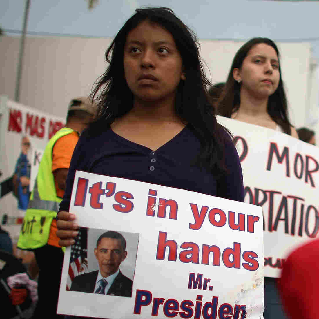 "A young immigration activist holds a sign reading ""It's in your hands Mr. President"" during a rally calling on President Obama to suspend deportations in 2013."