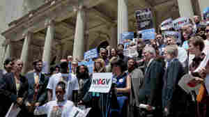 Anti-gun groups and state officials joined New Yorkers Against Gun Violence to mark the sixth month anniversary of the Newtown massacre on the steps of New York City Hall in 2013.