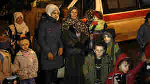 People wait to leave the besieged town of Madaya, northwest of Damascus, Syria, on Jan. 11.