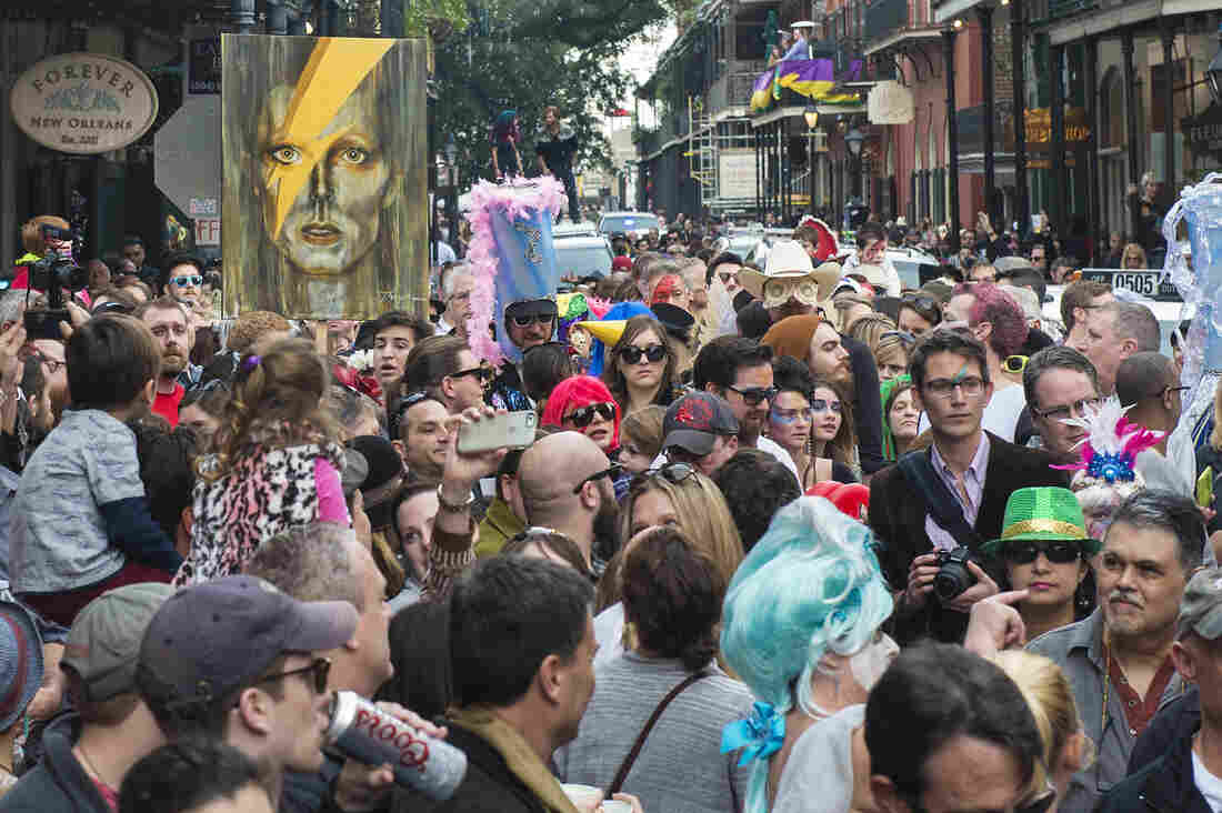 Paraders and onlookers at the corner of Royal and St. Peter streets as Arcade Fire and Preservation Hall Jazz Band lead a memorial parade for David Bowie through the French Quarter on Jan. 16.