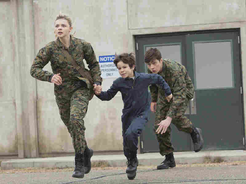 "Chloë Grace Moretz, Zachary Arthur and Nick Robinson in Columbia Pictures' ""The 5th Wave."""