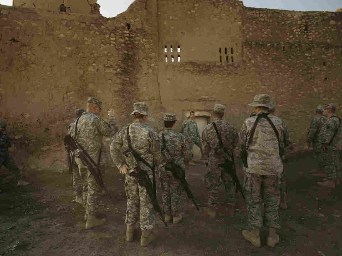 In this photo from Nov. 7, 2008, a U.S. Army chaplain leads soldiers on a tour of St. Elijah's Monastery on Forward Operating Base Marez on the outskirts of Mosul, Iraq. The monastery was apparently destroyed by ISIS in 2014.