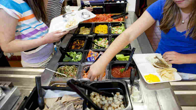 Students at Doherty Middle School in Andover, Mass., choose items from the salad bar in the school cafeteria, June 2012. Among other things, a Senate compromise on school nutrition standards calls for the USDA and the CDC to establish new guidance that would encourage the use of salad bars.