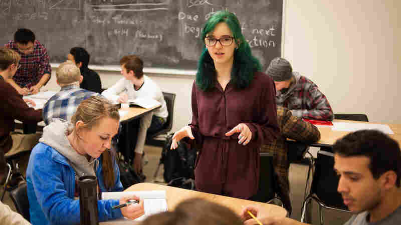 Amelia Westerdale works with physics students during a tutorial session at the University of Colorado Boulder. Westerdale is part of the Learning Assistant Program, tasked with helping to coach and tutor students.