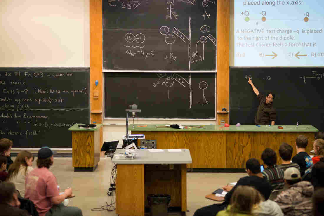 Professor Steven Pollock teaches a physics class at the University of Colorado Boulder. Pollock helped found the Learning Assistant Program and conducts research in physics education.