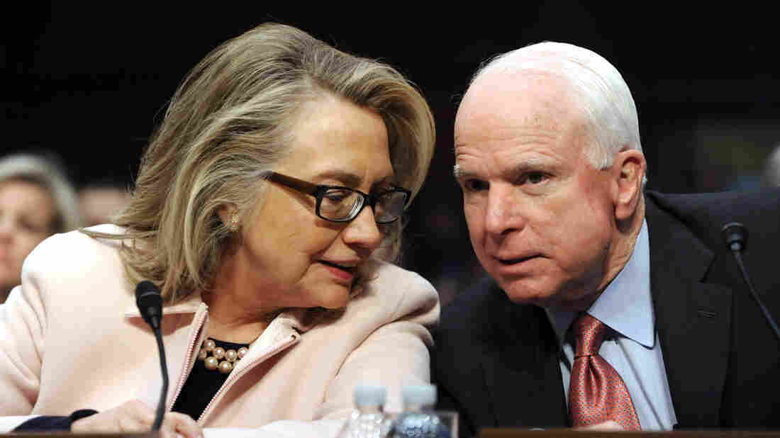 Hillary Clinton confers with Republican Sen. John McCain in 2013.