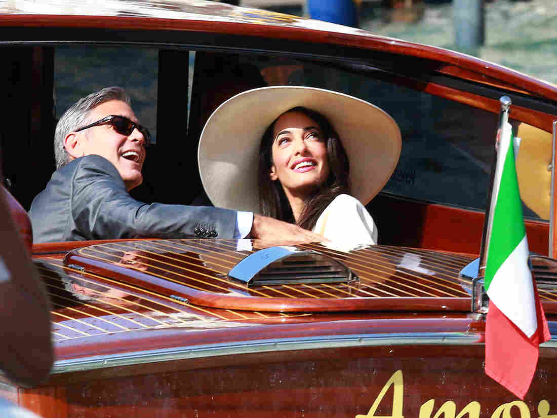 George Clooney and Amal Alamuddin make their way to their civil wedding in Venice, Italy, on Sept. 29, 2014.