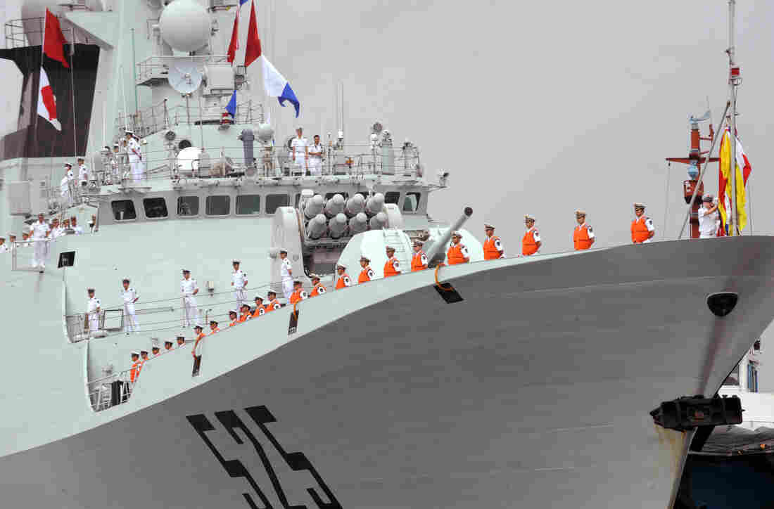 In Djibouti, China will build what's believed to be its first overseas military base. Here, Chinese sailors stand on the deck of the flagship missile frigate Ma'Anshan, which saw action against pirates off Somalia's coast in 2010.