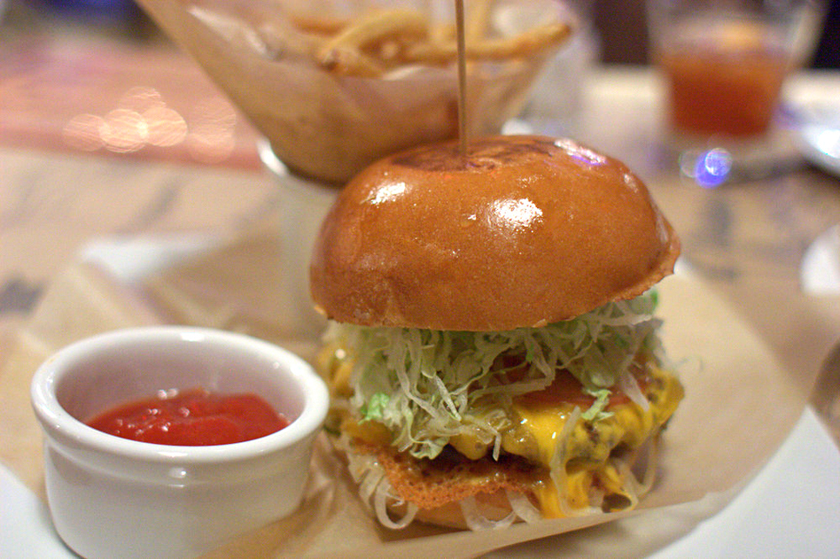 "The Big Bite Burger from Guy's American Kitchen and Bar in New York's Times Square. In 2012, <em>New York Times</em> restaurant critic Pete Wells penned an <strong><a href=""http://www.nytimes.com/2012/11/14/dining/reviews/restaurant-review-guys-american-kitchen-bar-in-times-square.html"">infamous takedown</a></strong> of the restaurant. (Krista/Flickr)"