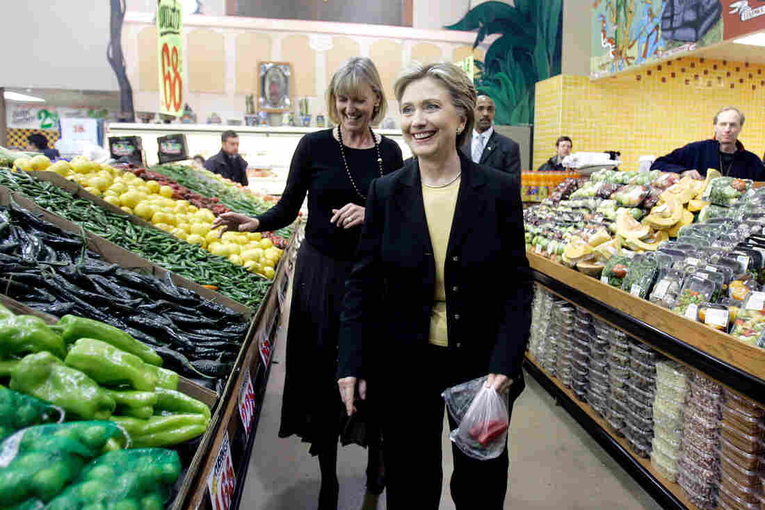 Democratic presidential hopeful Hillary Clinton walks past the peppers at the El Rey grocery store in Milwaukee, Wis., during a campaign stop in 2008. Clinton tells NPR that she eats a fresh hot pepper a day to stay healthy on the campaign trail. She may be on to something.