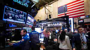 Traders work on the floor of the New York Stock Exchange in New York on Jan. 4.