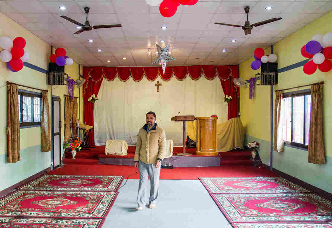 Tej Rokka is a Nepali pastor who works with the evangelical group Climbing for Christ. He's standing inside Savior Alone Redeems Asians church, in Kathmandu, where he preaches.