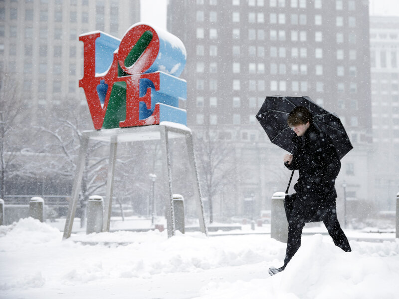 "A man walks through the snow during a winter storm at at JFK Plaza, commonly known as Love Park, in Philadelphia. Why are such storms linked with an uptick in births? Researcher Richard Evans has a theory: ""If the lights go out and there's no TV, it kind of sets the table for romance."""