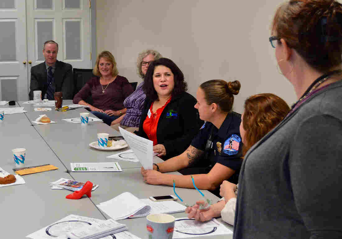 Jennifer Stout, center, is the state director of Eckerd, a nonprofit that provides family coaching services in Rutland. She regularly attends community coffee klatsches at the Rutland Police Department. Stout and other participants say these types of meetings have helped agencies share information and strategies to tackle drug abuse, crime, mental health problems and domestic violence.