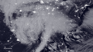 An image taken by satellite in the wee hours of Friday morning shows the storm bearing down on the East Coast.