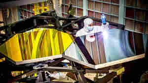 A NASA team has attached nearly all of the hexagonal segments that will together make the primary mirror for the James Webb Space Telescope (pictured are practice segments).