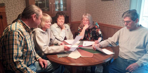 Surry County residents from left, Terry Marshall, Dr. Katherine Kellam, Donna Bryant, Mary Marshall and Jesse Hardy lend support to each other during a meeting at Bryant's home in the Shoals community. Mary Marshall says the odor and pollution from nearby chicken farms can make it hard to breathe.