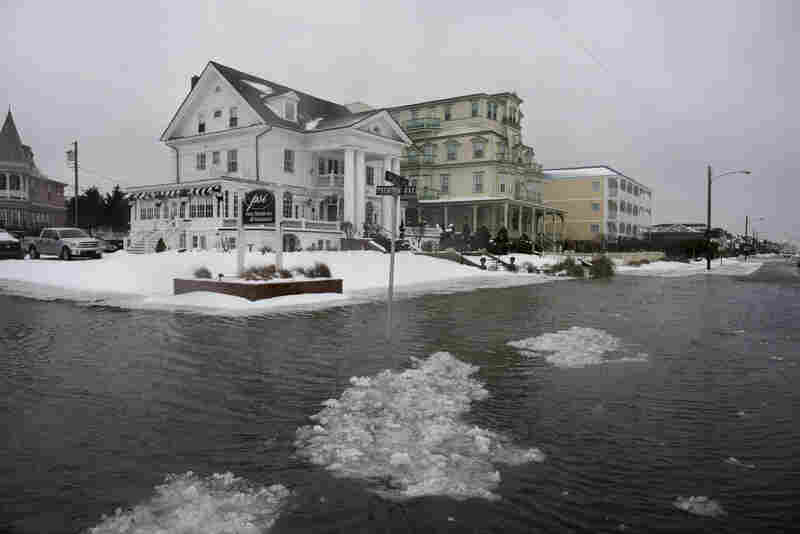 Ice forms as the winter storm mixed with high tide causes flooding on Beach Avenue on Jan. 23 in Cape May, N.J.