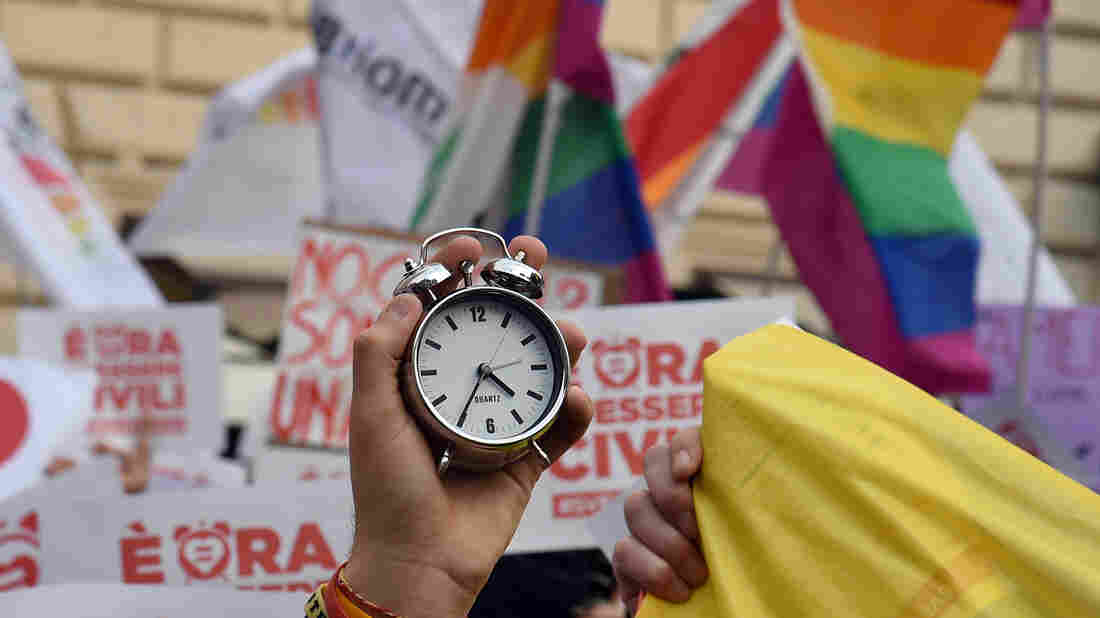 """Supporters of same-sex civil union hold alarm clocks """"to wake up Italia"""" on January 23, near the Pantheon in central Rome. Italy is the only major Western European country not to have enacted legislation allowing gay couples to have their relationships legally recognized and protected. A bill which the Senate will start examining on Thursday would enable same-sex couples to enter civil unions."""