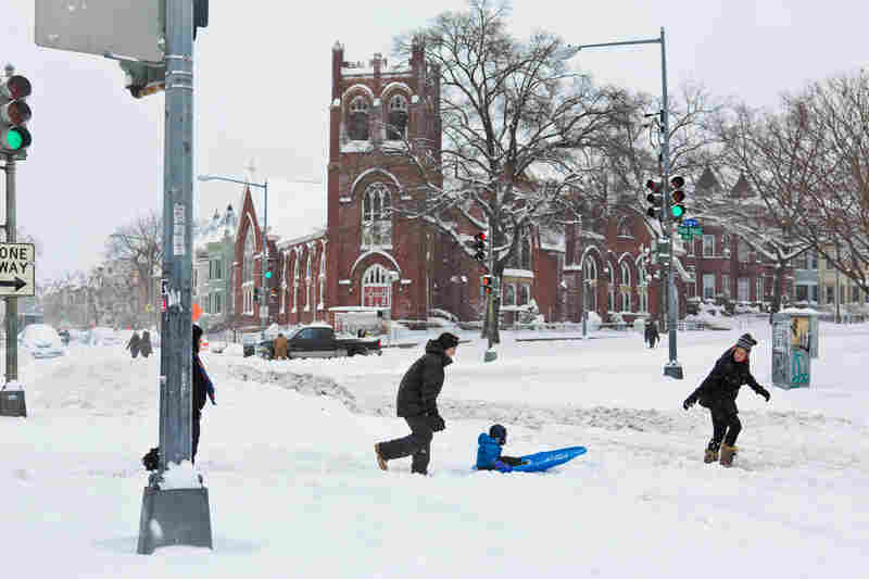 Residents take advantage of a break in the snow to wander down Rhode Island Avenue in Washington, D.C.