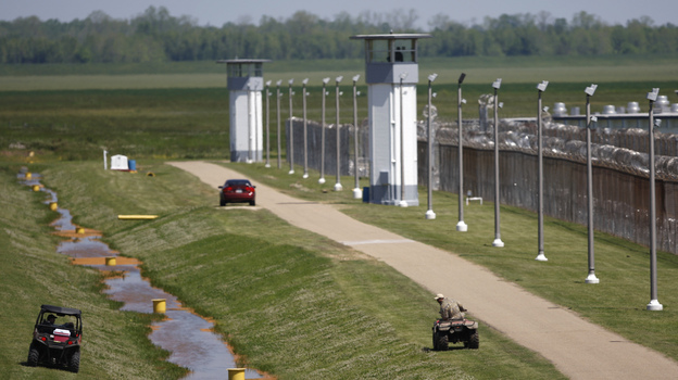 Louisiana State Penitentiary workers inspect levees near the prison, also known as Angola, in 2008. Henry Montgomery, who has been held there for more than 50 years after being sentenced to life at 17, may be resentenced after winning his Supreme Court case on Monday. (AP)