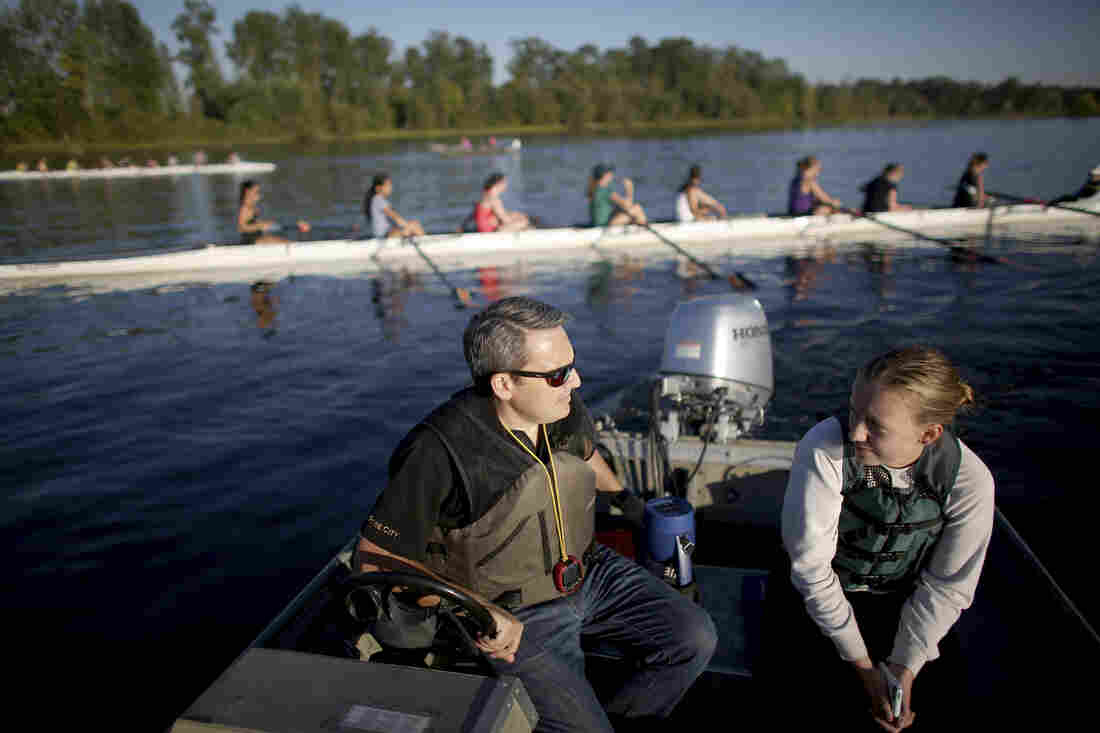 Coach Nick Haley talks with a student during crew practice in Portland, Or. He stresses teaching over friendship.