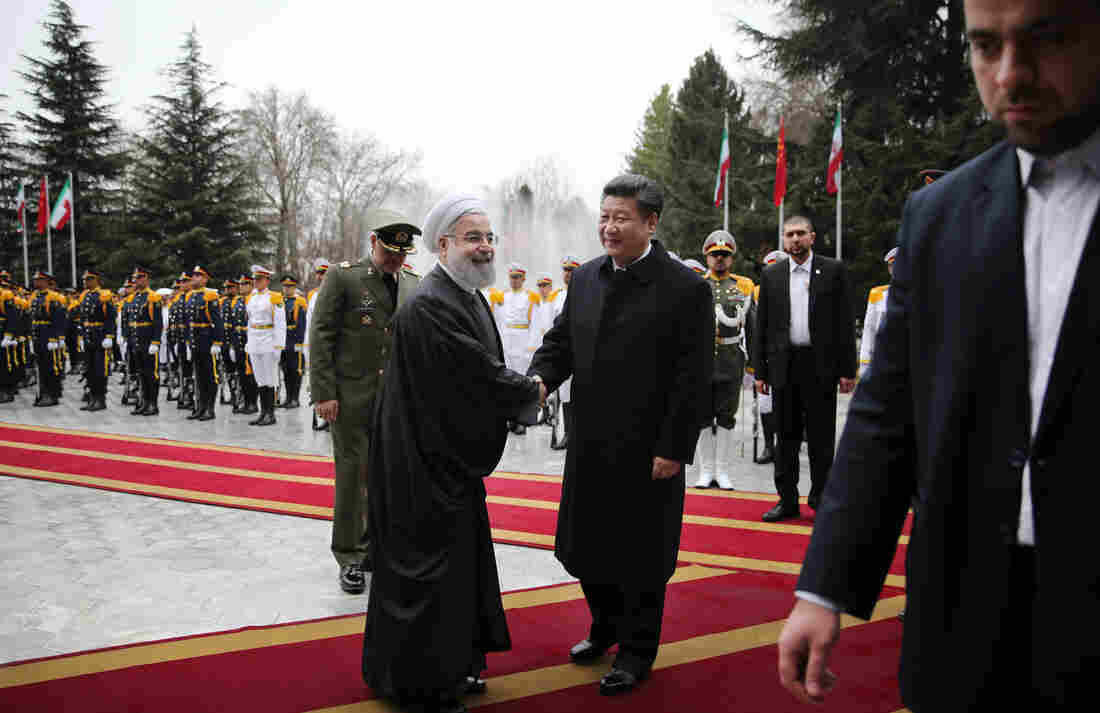 Iranian President Hassan Rouhani greets visiting Chinese President Xi Jinping at the Saadabad Palace in Tehran on Saturday. With sanctions lifted, the countries pledged to develop economic ties.