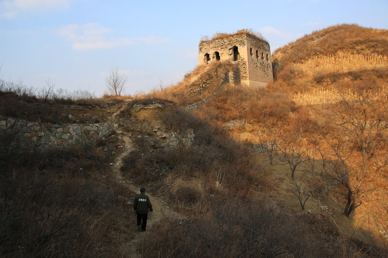 Qiao Guohua patrols a 5-mile stretch of the Great Wall of China. Roughly a third of the wall's 12,000 miles have crumbled to dust, and saving what's left may be the world's greatest challenge in cultural preservation. (Anthony Kuhn/NPR)