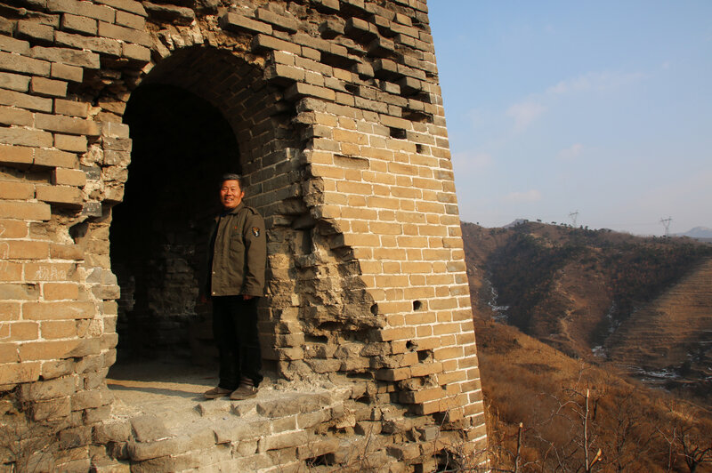 Qiao Guohua, a resident of Jielingkou village, is paid a small sum of money by the local government to patrol a section of the Great Wall. He's come to know every feature of the wall and its surrounding landscape intimately. (Anthony Kuhn/NPR)