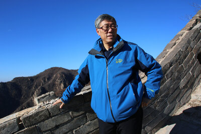 Dong Yaohui, vice chairman of the China Great Wall Society, walks on a relatively intact section of the wall near its eastern end. Dong was among three men who, in the 1980s, were the first Chinese known to have walked the wall's entire length from east to west. (Anthony Kuhn/NPR)