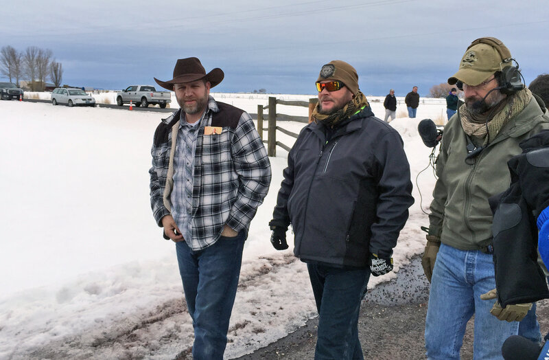Ammon Bundy (left) approaches an FBI gate at the Burns Municipal Airport in Oregon on Friday. Bundy, the leader of an armed group occupying a national wildlife refuge to protest federal land policies, was among several people arrested Tuesday. Another member of the group was killed.