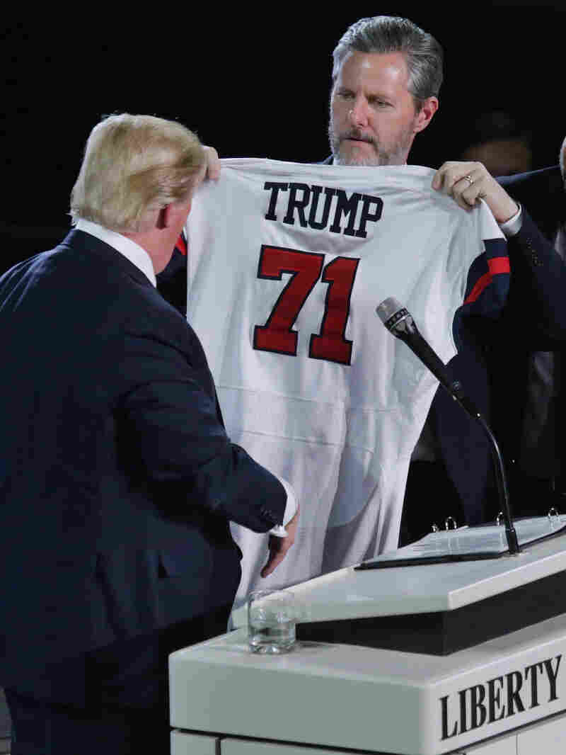 Liberty University President Jerry Falwell Jr. presents Republican presidential candidate Donald Trump with a sports jersey after Trump delivered the convocation last week.