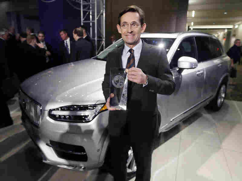 Lex Kerssemakers, CEO of Volvo North America, stands next to the Volvo XC90 after the model was named the truck/utility of the year at the North American International Auto Show, Jan. 11 in Detroit.