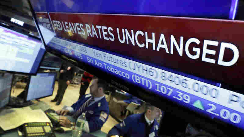 Traders on the New York Stock Exchange greet the news that the Federal Reserve has decided against another interest rate hike.